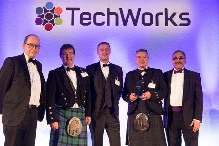 Members of the Compugraphics team receiving an award under the TechWorks logo